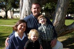 Familia joven en azul Foto de archivo libre de regalías
