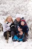 Familia joven en invierno Imágenes de archivo libres de regalías