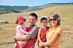 Familia joven feliz Imagen de archivo libre de regalías