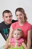 Familia joven feliz Foto de archivo libre de regalías