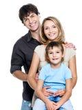 Familia joven feliz con el niño bonito Imagen de archivo libre de regalías