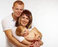 Familia joven sonriente Fotografía de archivo