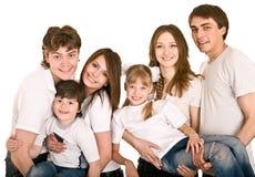 Familia, muchacho y muchacha felices. Fotografía de archivo