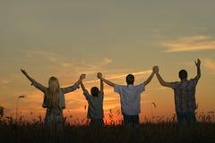 Familia que celebra la mirada de las manos Fotografía de archivo