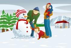 Familia que hace el muñeco de nieve Imagen de archivo