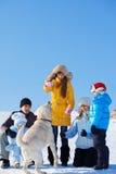 Familia que juega con el perro Fotografía de archivo libre de regalías