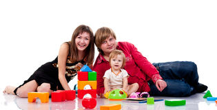 Familia que juega con los juguetes Imagenes de archivo