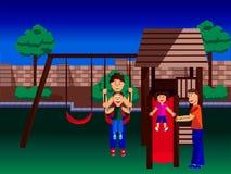 Familia que juega en un sistema del oscilación Imágenes de archivo libres de regalías