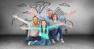 Familia que se divierte con el dibujo del jardín Fotos de archivo