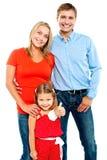 Familia sonriente en un fondo blanco Imagenes de archivo