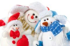 Familia sonriente feliz del muñeco de nieve Imágenes de archivo libres de regalías