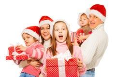 Familia sorprendida con los presentes y imagenes de archivo