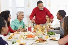 Familia toda junto en la cena de la Navidad Fotos de archivo libres de regalías