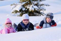 Familia y nieve Foto de archivo libre de regalías