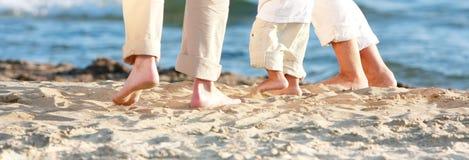 Familie auf Strand Stockbilder