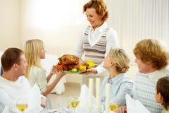 Familie bij diner Stock Fotografie