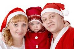 Familie in de kostuums van Kerstmis Stock Foto