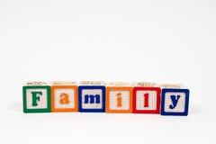 Familie in den Blockschrift Stockfoto