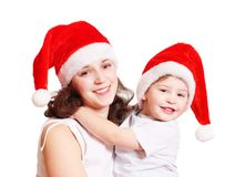 Familie in den Weihnachtshüten Lizenzfreies Stockbild