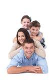 Familie, die auf einander liegt Stockfotografie