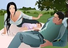 Familie, die draußen genießt Stockbild