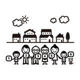 Familie, die im fromt von Häusern steht Lizenzfreies Stockbild