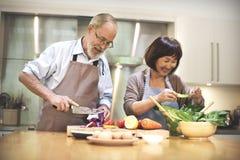 Familie, die Küchen-Lebensmittel-Zusammengehörigkeits-Konzept kocht Lizenzfreies Stockbild