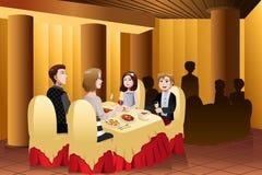 Familie die uit in een restaurant eten stock illustratie
