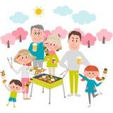 Familie die van barbecue in openlucht geniet Stock Afbeeldingen