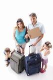 Familie die van vakantie wordt vermoeid stock afbeeldingen