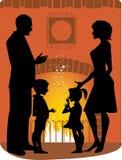 Familie door de open haard Royalty-vrije Stock Foto