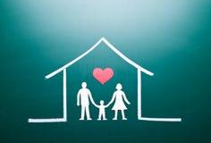 Familie in een huis Stock Foto's