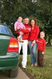 Familie en auto Stock Foto's