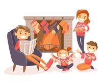 Familie het vieren Kerstmis door de open haard Royalty-vrije Stock Afbeeldingen