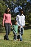 Familie im Park. Lizenzfreies Stockfoto