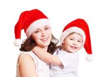 familie in Kerstmishoeden Royalty-vrije Stock Afbeelding