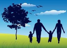 Familie met het gebied van de kinderenzomer Stock Foto's