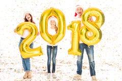 Familie met 2018 Nieuwe jaarballons Stock Foto