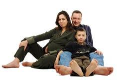 Familie met zwangere moeder Stock Foto