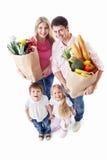 Familie mit dem Einkaufen stockbild