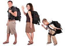Familie mit Rucksäcken lizenzfreie stockfotos