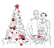 Familie nahe dem Weihnachtsbaum Lizenzfreie Stockbilder