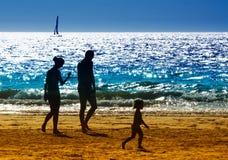 Familie op het strand Stock Afbeelding