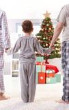 Familie op Kerstmisochtend Royalty-vrije Stock Foto's