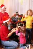 Familie in rode Kerstmishoed Royalty-vrije Stock Foto's