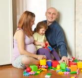 Familie van drie in huis Stock Foto's