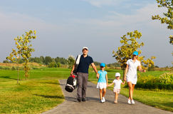Familie van golfspelers Stock Foto's
