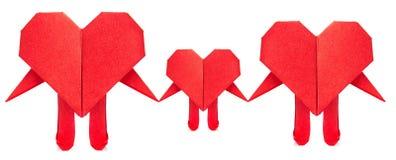 Familie van rode hartorigami Stock Foto