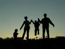 Familie van silhouet vier royalty-vrije stock fotografie