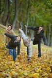 Familie van vier die spelen Stock Foto's